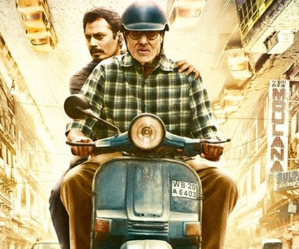 Amitabh Bachchan and Nawazuddin Siddiqui riding a blue scooter